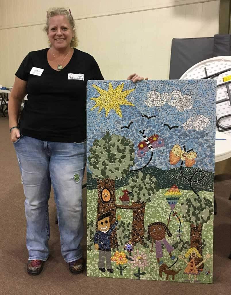 Karen Sasine with Kids Mosaic Artwork